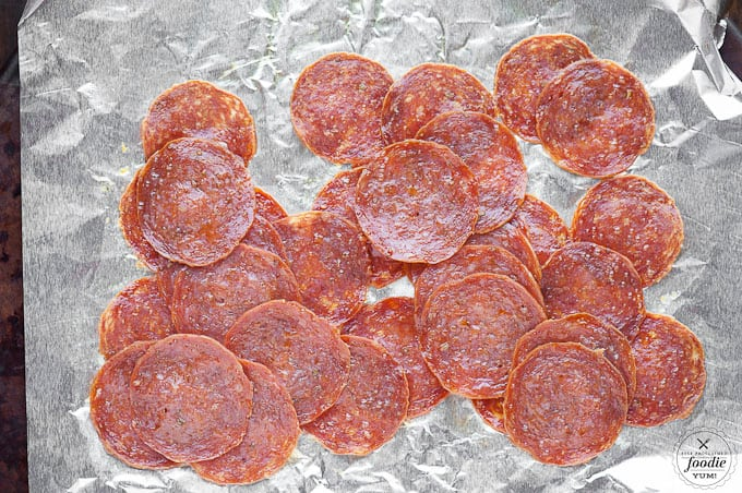 Pepperoni Pizza Pull Aparts take traditional pizza ingredients and turn them into a two bite appetizer perfect for any party or game day feast.