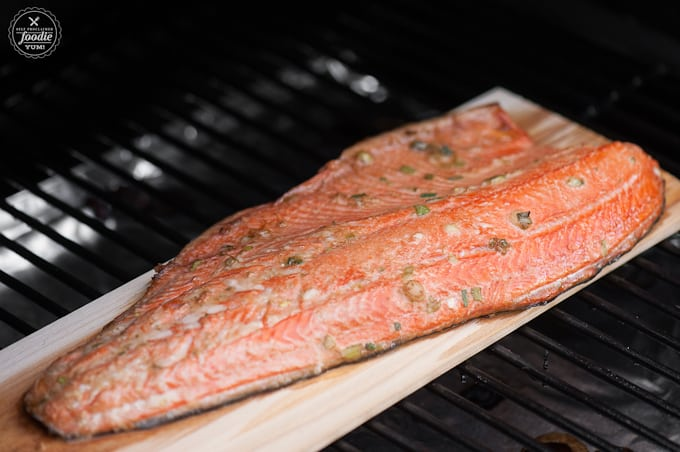 This easy Perfect Cedar Planked Grilled Salmon is wild caught Copper River Salmon marinated in a light Asian marinade grilled into a healthy summer dinner.
