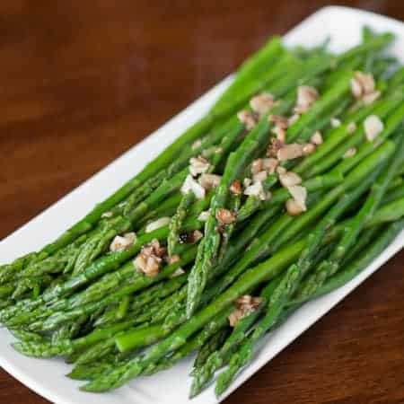 Perfect Garlic Sauteed Asparagus is the best way to cook asparagus. This delicious and easy garlic asparagus is cooked in less than ten minutes!