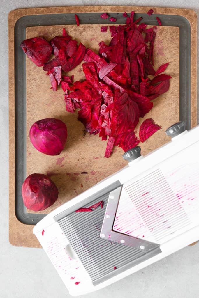 shredding beets with mandolin