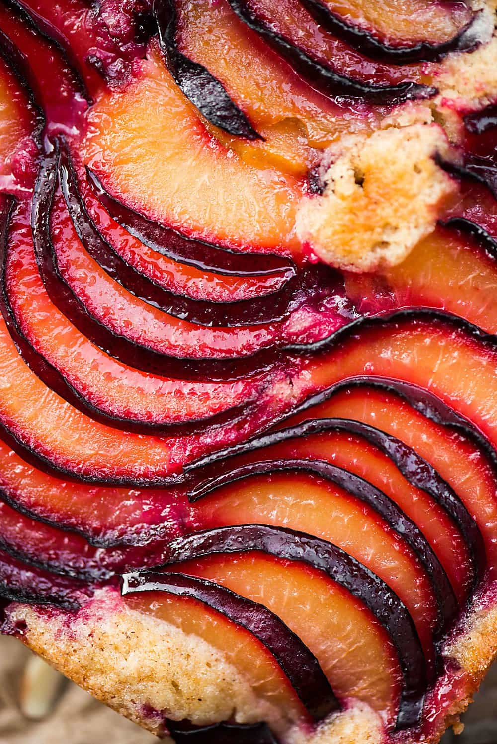 Thinly sliced fresh plum top this incredibly moist and flavorful cake. This Plum Almond Cake is not only easy to make, but it's a gorgeous dessert.