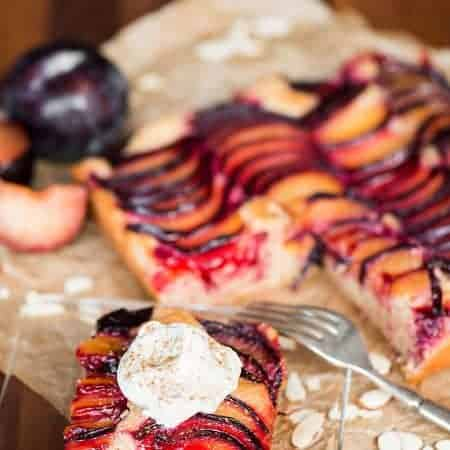 plum almond cake topped with whipped cream