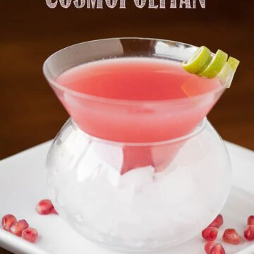 a pink pomegranate Cosmopolitan with vodka in glass