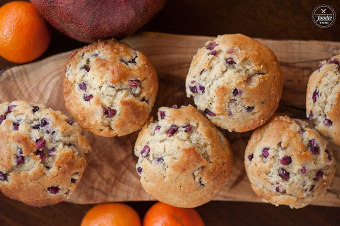 tops of homemade muffins that have pomegranate seeds
