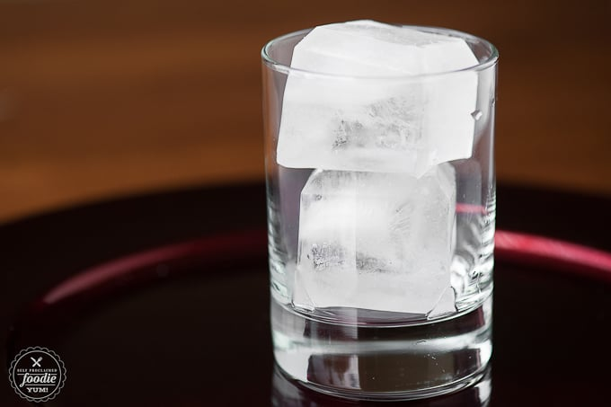 a glass with two large ice cubes