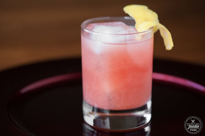 A glass of Pomegranate whiskey Sour
