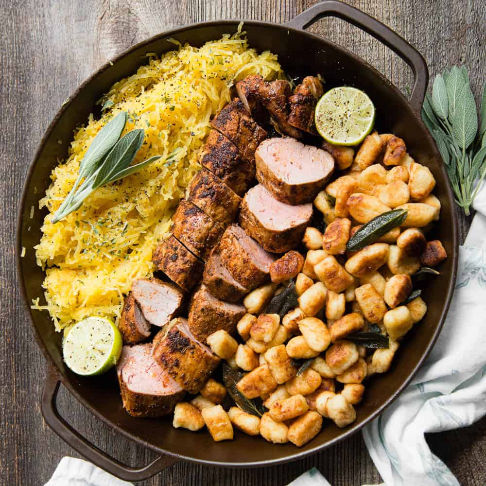 pork tenderloin in large round skillet with gnocchi and spaghetti squash