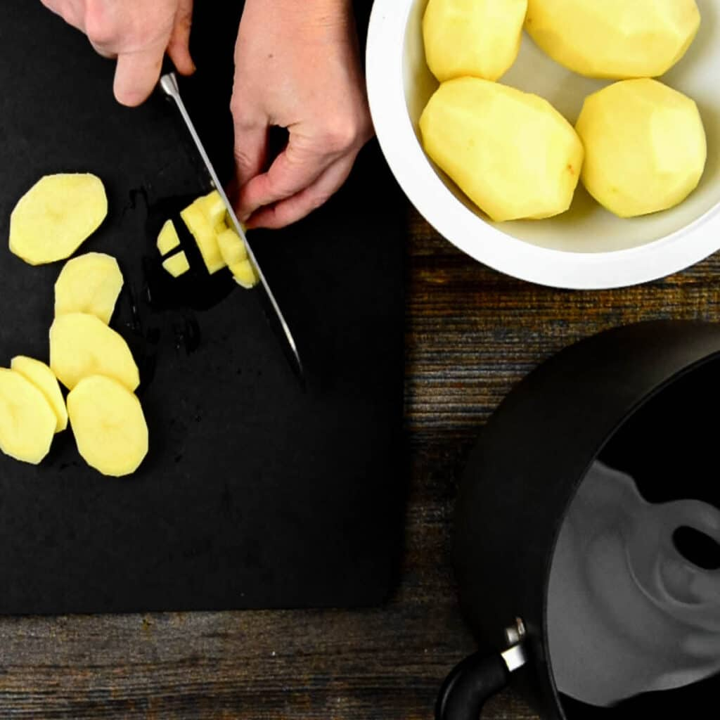 chopping peeled potatoes