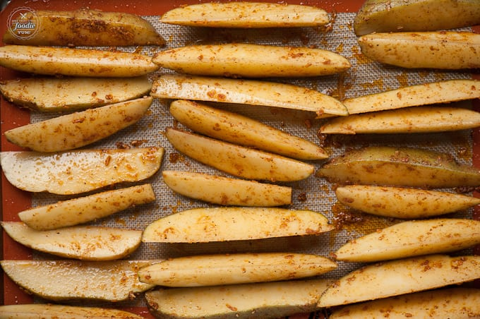 Oven baked and perfectly seasoned Potato Wedge Fries are easy to make and make a great side for your burger or dog.