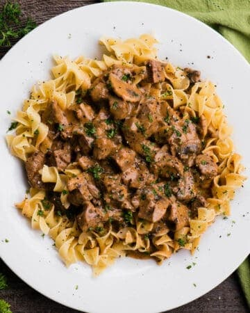 homemade Beef Stroganoff with fresh mushrooms over noodles