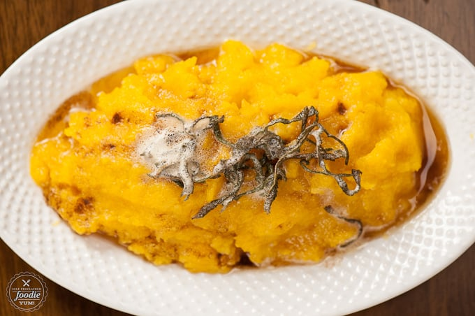 butternut squash with sage brown butter in a bowl