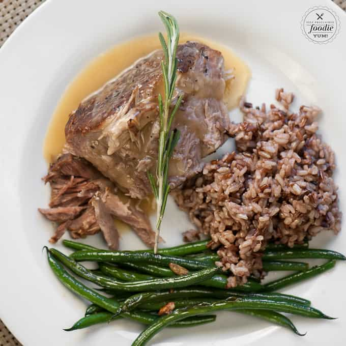 Plate with pressure cooker pork roast, gravy, rice and green beans