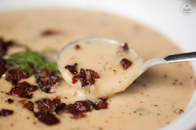 spoonful of potato leek soup with bacon