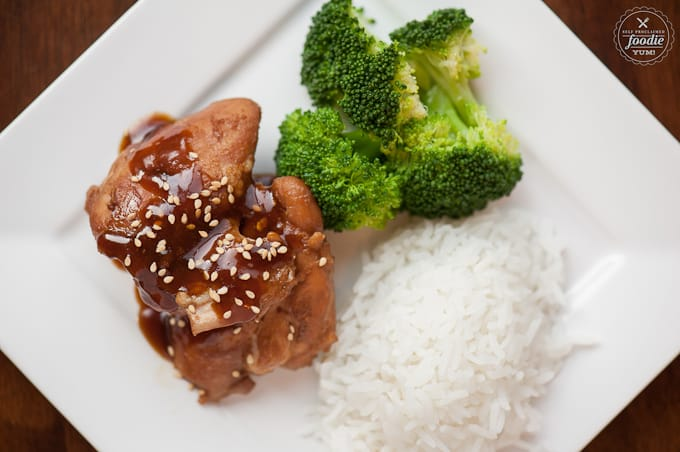 A plate of food with rice, broccoli, and shoyu chicken
