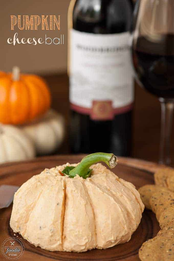 This delicious Pumpkin Cheese Ball made with real pumpkin and three different kinds of cheese is the perfect fall party appetizer when served with wine.