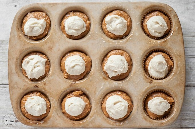 Muffin or cupcake? Its hard to tell with these incredibly moist, super tasty, and slightly naughty Pumpkin Cheesecake Muffins. You will love them!