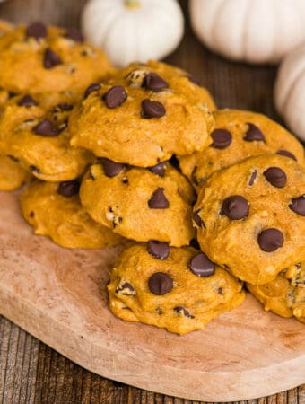homemade Pumpkin Chocolate Chip Cookies on wooden platter