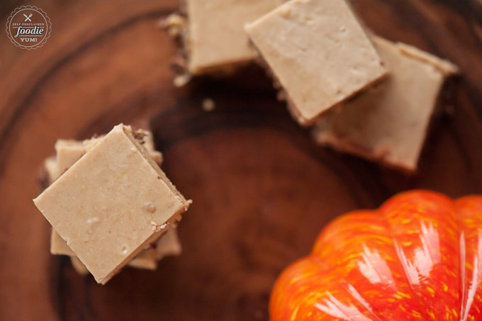 Homemade Pumpkin Chocolate Crunch Fudge combines smooth pumpkin spice fudge with a delicious Nestlé® Crunch® bottom for the perfect fall dessert.