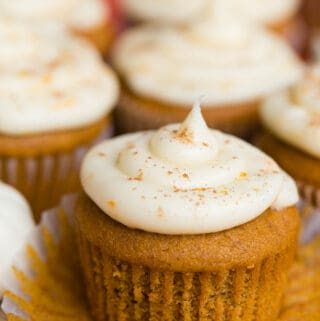 Pumpkin Cupcakes with a Citrus Cream Cheese Frosting with muffin liner pulled down