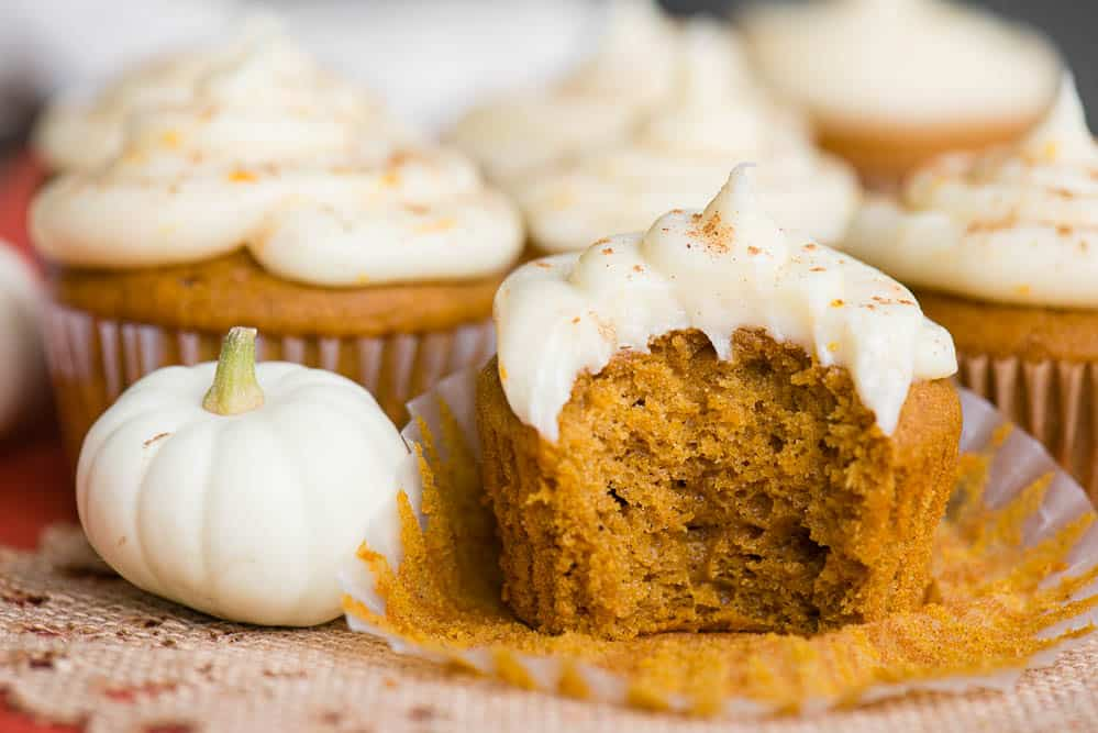 Pumpkin Cupcakes with a Citrus Cream Cheese Frosting with bite taken out