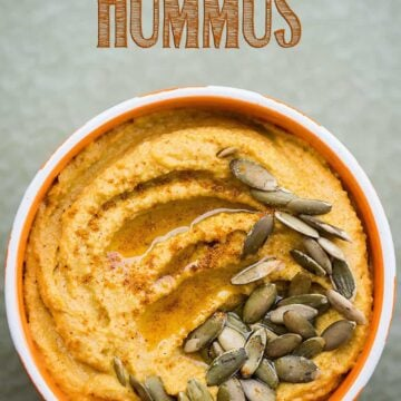 pumpkin curry hummus in a white and orange bowl