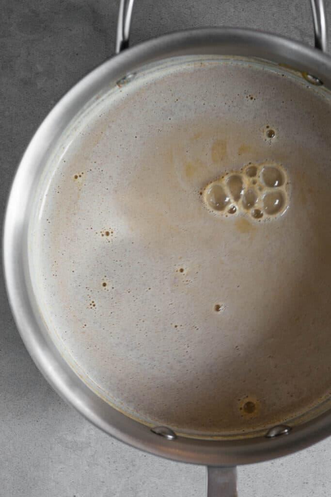 heated milk with cinnamon in pot