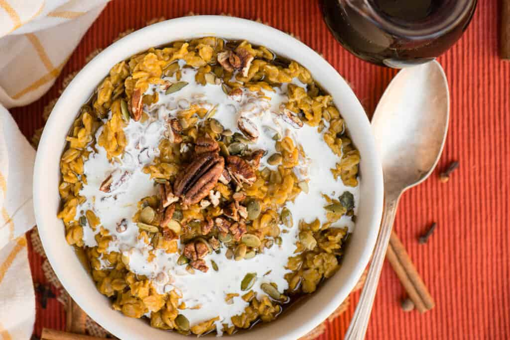 oatmeal made with pumpkin topped with cream