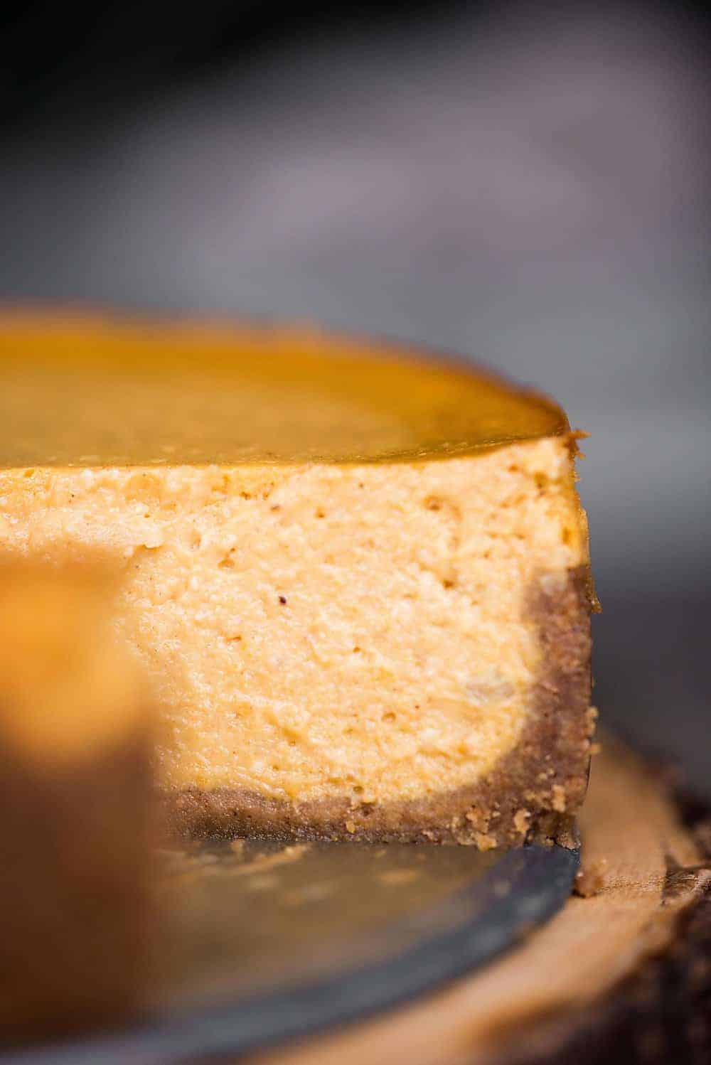 Easy Pumpkin Cheesecake is the perfect fall dessert. Made from scratch using quality ingredients, it is the best pumpkin cheesecake recipe you'll find!