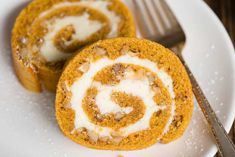 one slice of Pumpkin Roll with cream cheese filling