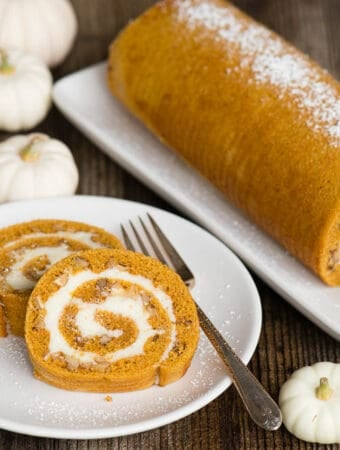 two slices of Pumpkin cream cheese Roll on white plate
