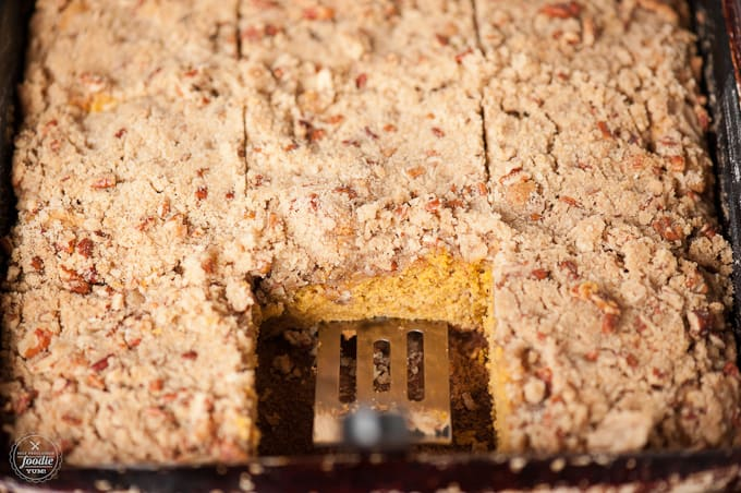 A close up of a piece of coffee cake with pumpkin