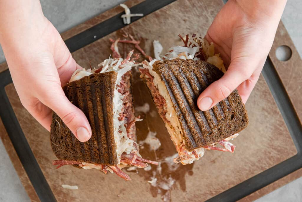 splitting apart a cut Reuben Sandwich