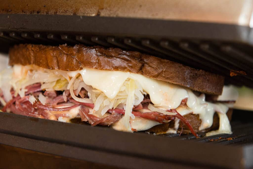 Reuben Sandwich in press with melted cheese