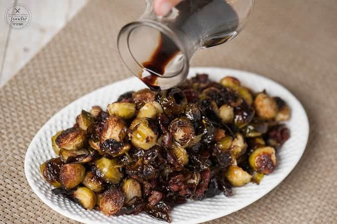 Roasted Balsamic Bacon Brussels Sprouts are an easy and flavorful side dish perfect for a weekday family dinner or a Thanksgiving or Christmas holiday meal.