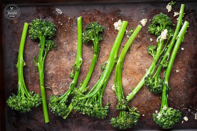 broccolini and garlic on a pan