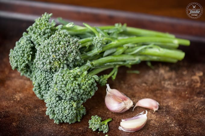 a close up of broccolini and garlic