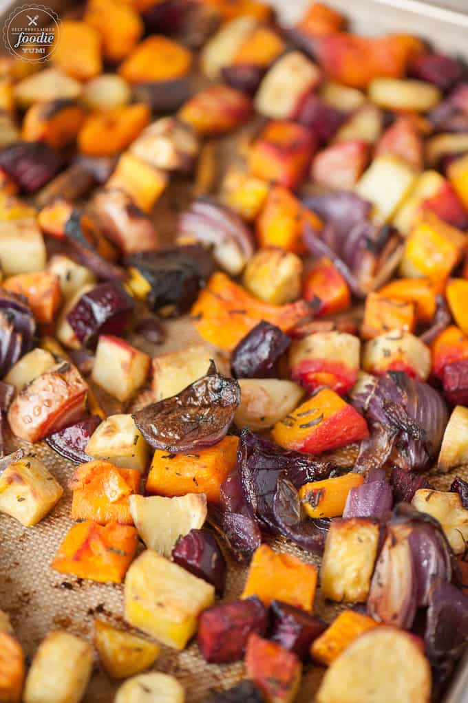 Fall is the perfect time to enjoy a rainbow of healthy Roasted Root Vegetables as a perfect side dish to any weekday family dinner or holiday meal.