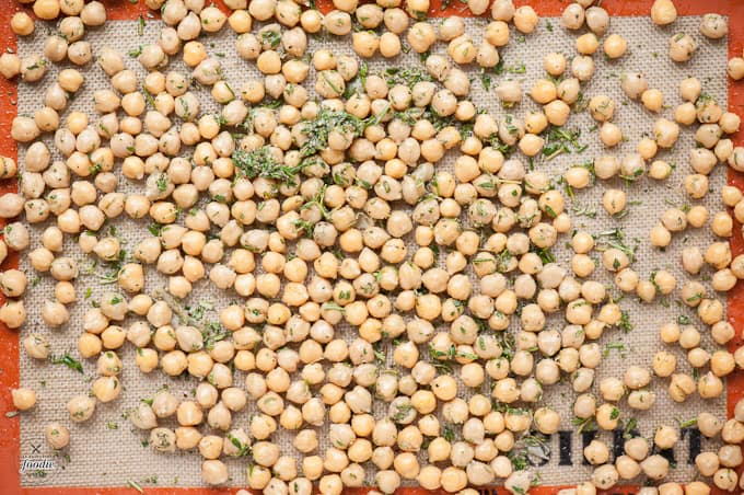If you're looking for a tasty snack packed full of nutritional benefits, you can't beat these delicious and high in fiber Roasted Rosemary Thyme Chickpeas.