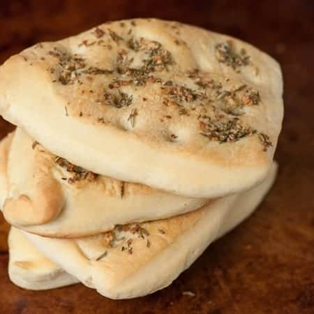 Homemade Rosemary Focaccia Flatbread is a rich and savory flat bread that has the same great olive oil taste as fluffy focaccia, but its more dense.