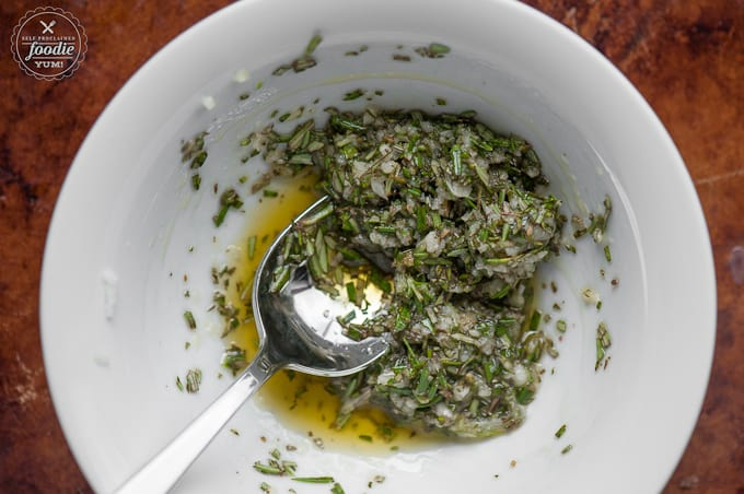 A bowl of rosemary, salt and olive oil