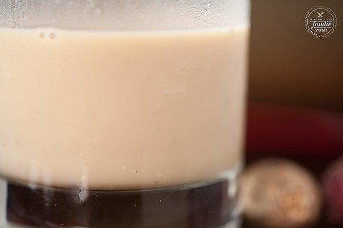 A close up of an eggnog cocktail