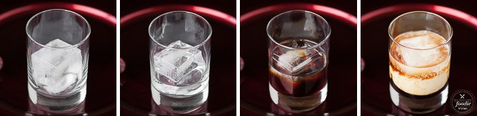a glass with vodka next to a glass with vodka and kahlua