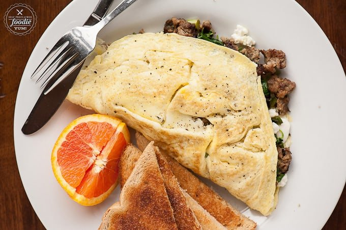 This Sausage Chèvre & Greens Omelet makes for a wonderful breakfast and has all the components you would want to start your morning right.