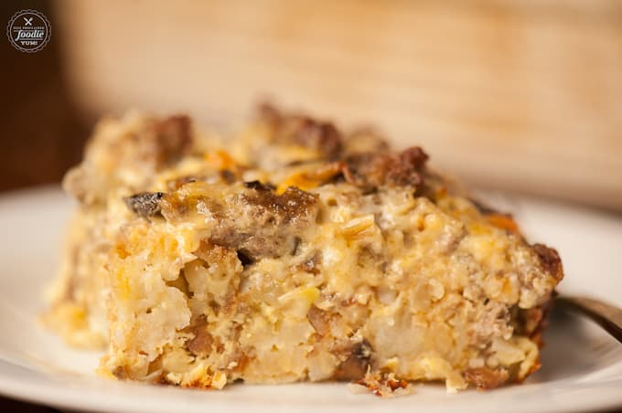 close up of sausage tater tot breakfast that is cooked as a casserole