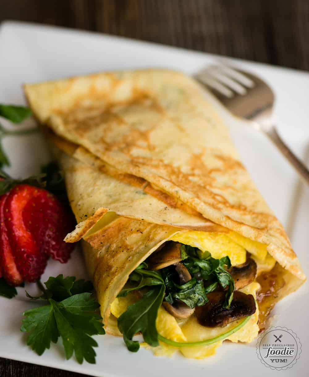 Recipe for Savory Breakfast Crepes with eggs, veggies, cheese, and bourbon bacon jam