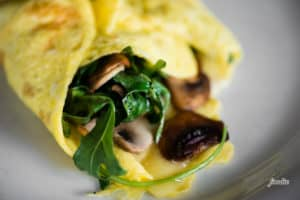 Eggs with arugula, mushroom, and cheddar