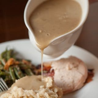 Savory Herb Turkey Gravy is the absolute best homemade turkey gravy from turkey drippings that you can serve with your Thanksgiving dinner.