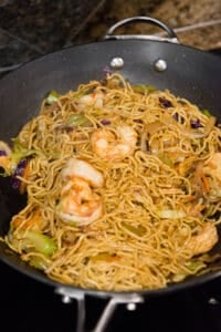 homemade shrimp chow mein in wok pan