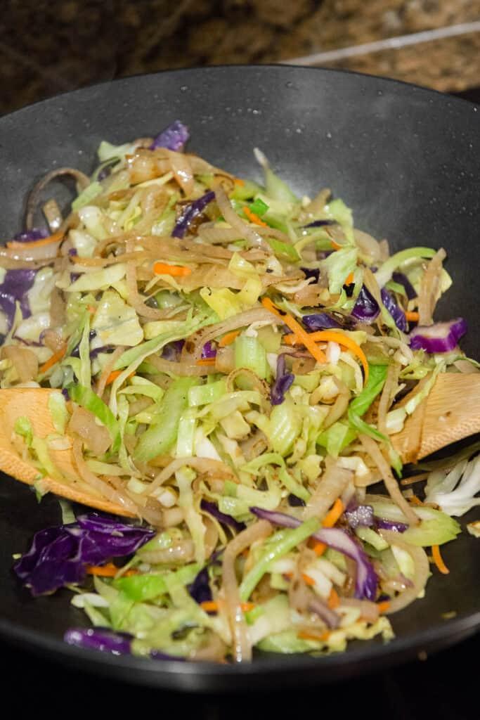 cabbage, onions, in celery stir fry in wok