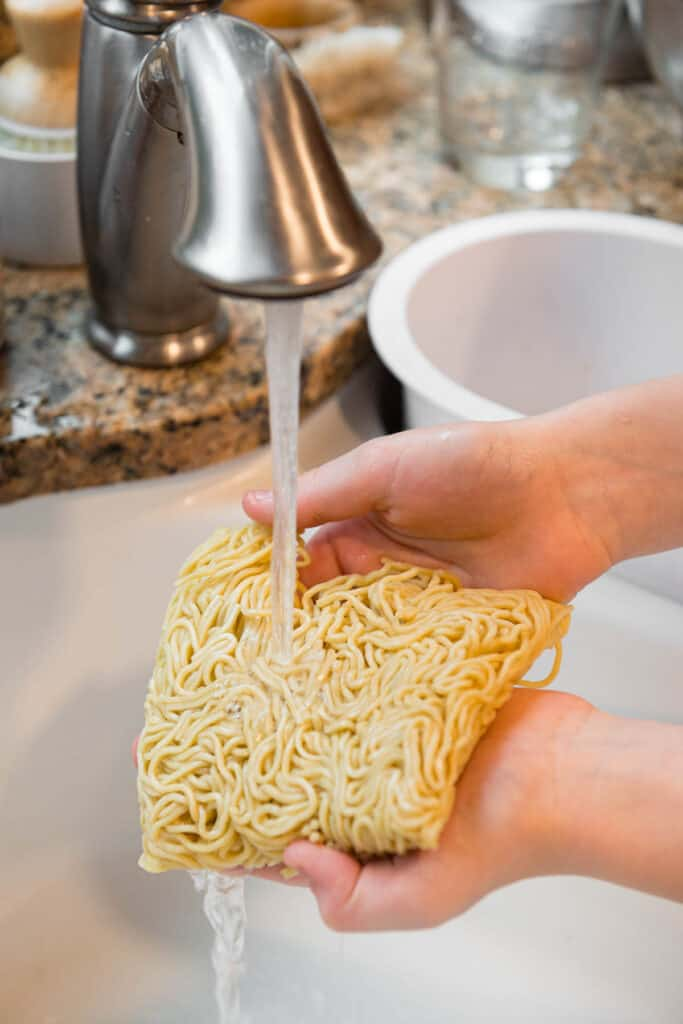 rinsing yakisoba noodles under running water